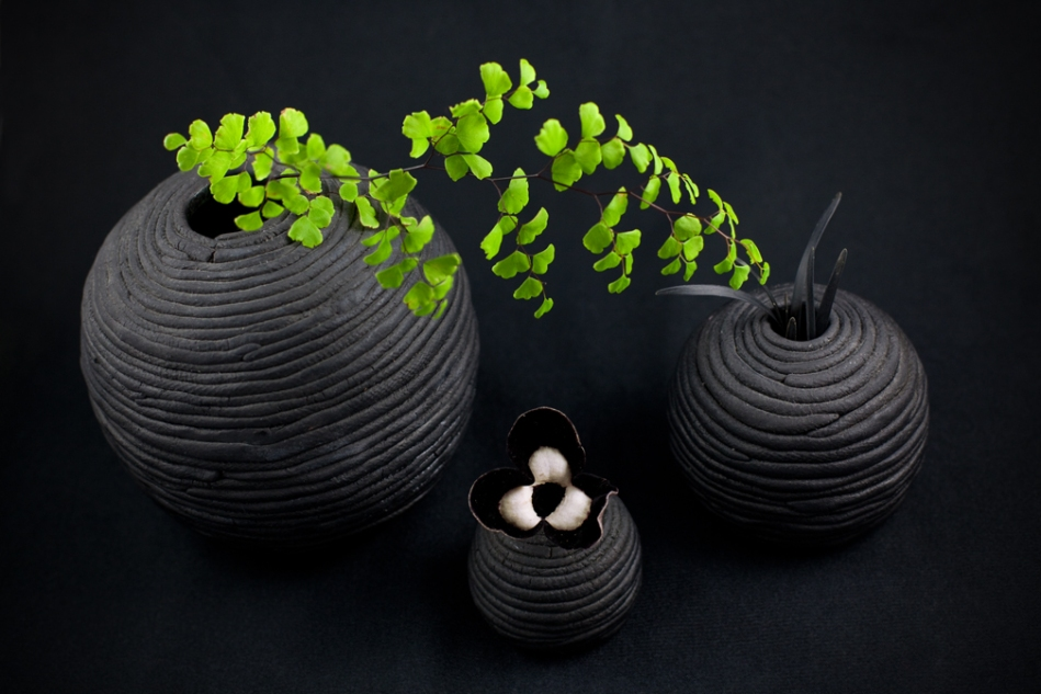 Panda Face Ginger AKA Asarum maximum 'Ling Ling' (Hexastylis) for the horticulture experts out there, under a shoot of maidenhair fern, flanked by black mondo grass. Ceramic vases by Lucy Lenoir.